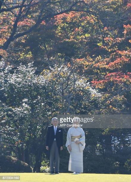 In this picture taken on November 9 Japanese Emperor Akihito and Empress Michiko pose during an Imperial garden party at Akasaka Palace Imperial...