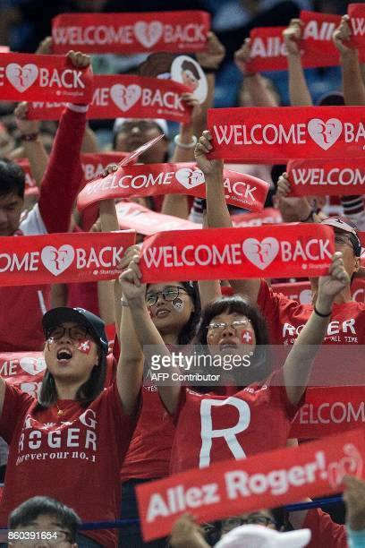 In this picture taken on October 11 supporters of Roger Federer of Switzerland shout his name during his men's second round singles match against...