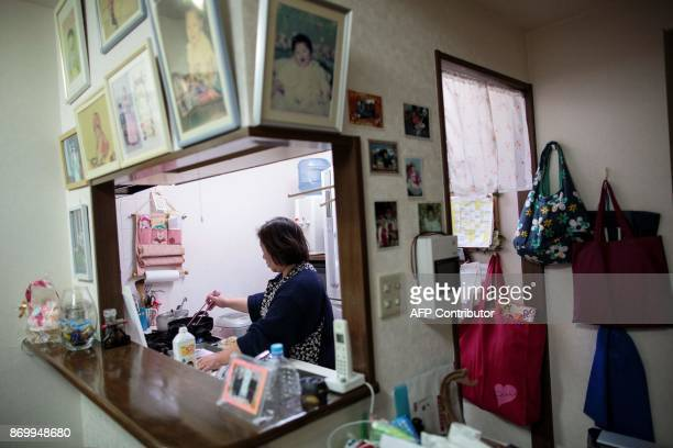 In this picture taken on October 13 Oh JongE mother of Tokyo Korean high school student Hwang SongWi cooks at home in Tokyo Portraits of North...
