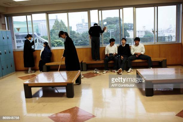 In this picture taken on October 13 students clean the coridor and rest during a break at Tokyo Korean high school in Tokyo Portraits of North...