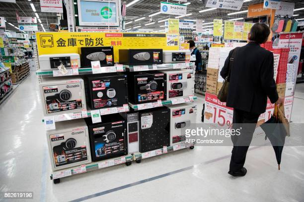 In this picture taken on October 17 a man walks past safes at a department store in Tokyo Japan's stock market may be riding at twodecade highs but...