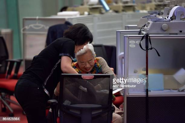 In this picture taken on October 19 Cheung a trader who worked on the floor since 1994 offers cake to a colleague as she prepares to leave on her...