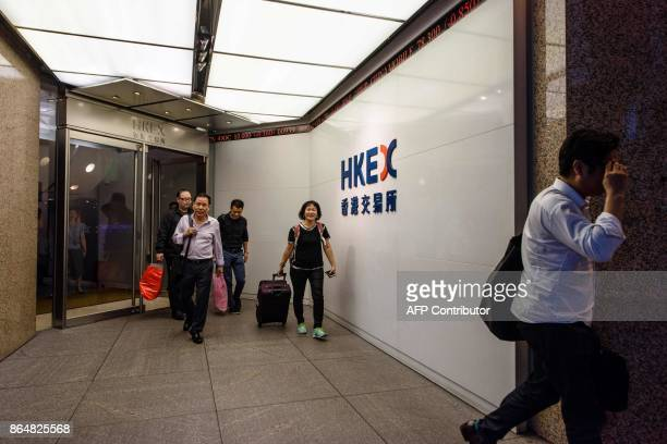 In this picture taken on October 19 Cheung a trader who worked on the floor since 1994 leaves the Hong Kong Stock Exchange after finishing her last...