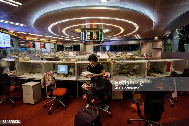 In this picture taken on October 19 Cheung a trader who worked on the floor since 1994 packs her belongings as she prepares to leave after her last...