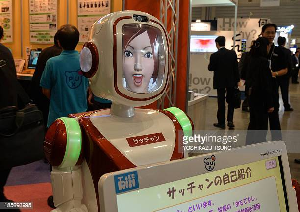 In this picture taken on October 23 Japan's robot venture Takerobo displays the guide robot 'Sacchan' which has 10 different animated faces at the...