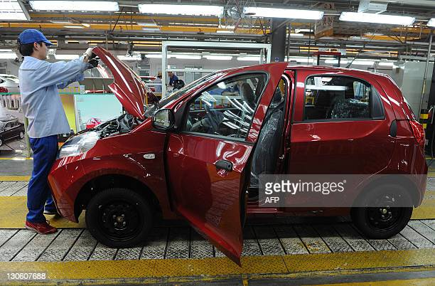 In this picture taken on October 26 2011 a worker assembles one of the many car models at Chinese carmaker's Chery Automobile plant in Wuhu east...