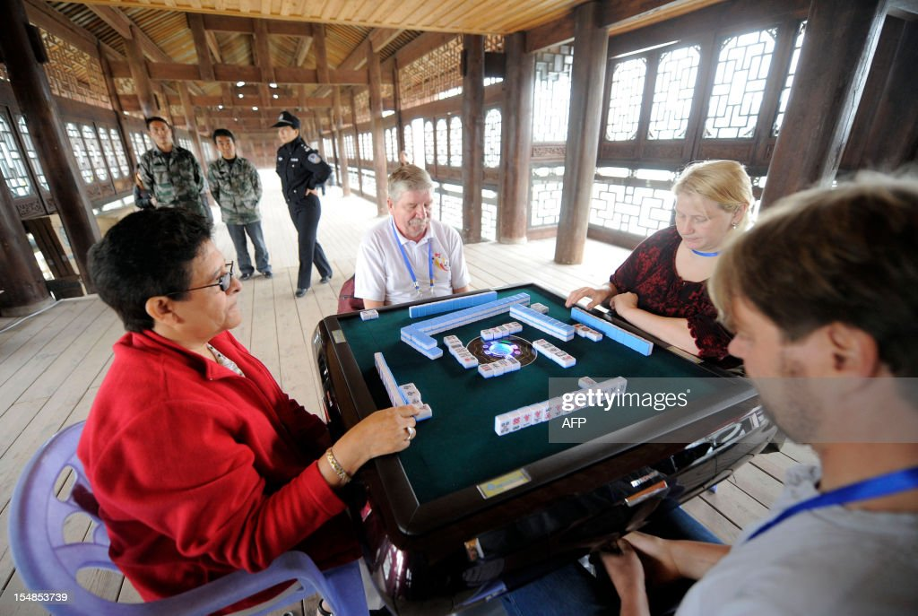 In this picture taken on October 27, 2012 participants compete in the first round of the 3rd Mahjong World Championship in Chongqing. Some 118 participants are taking part in the three-day competition for the title of the best Mahjong player in the world. CHINA OUT AFP PHOTO