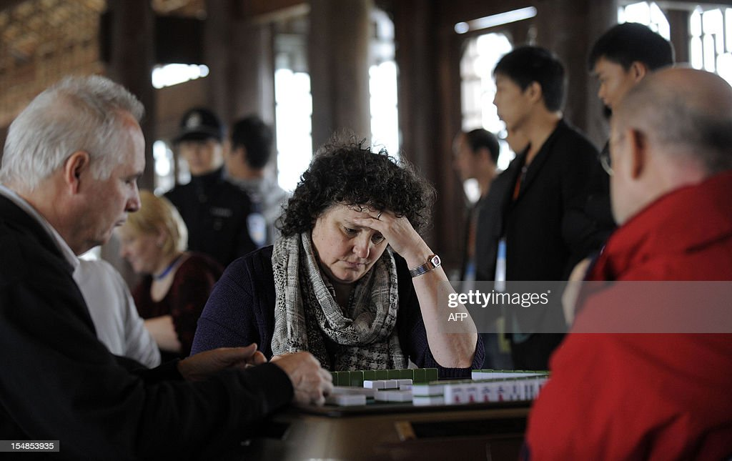In this picture taken on October 27, 2012 participants compete in the first round of the 3rd Mahjong World Championship in Chongqing. Some 118 participants are taking part in the three-day competition for the title of the best Mahjong player in the world. CHINA