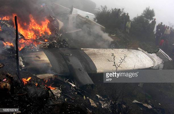 In this picture taken on October 9 bystanders look on as the wreckage of a Yeti Airlines aircraft burns at the airport in Lukla Mistakes by the crew...