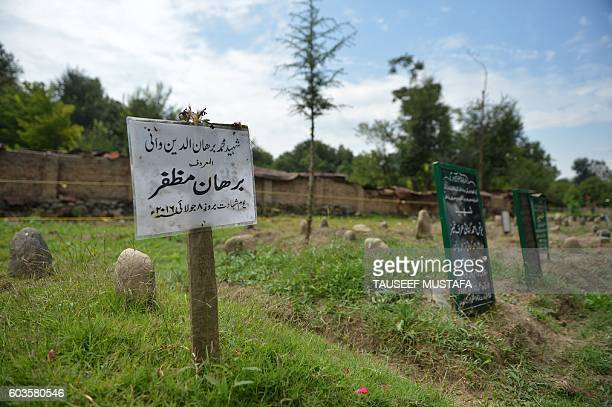 In this picture taken on September 12 the grave of slain rebel leader Burhan Wani is seen in his native Tral Since independence seven decades ago...