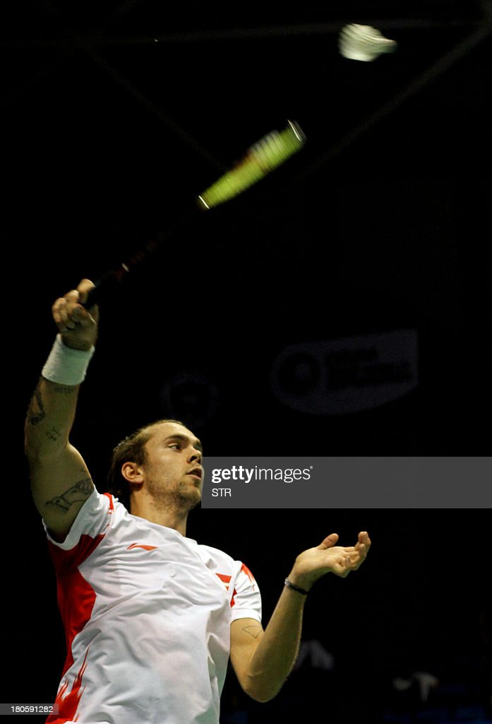 In this picture taken on September 14, 2013 Jan O Jorgensen of Denmark returns a shot against Wang Zhengming of China during the men's singles semifinal match of the 2013 China Masters in Changzhou, east China's Jiangsu province on September 14, 2013. Wang won 21-13,16-21, 23-21 to move into the final. CHINA