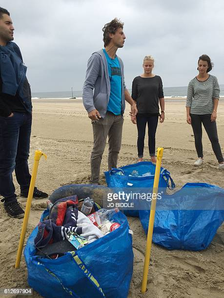 In this picture taken on September 16 2016 Dutch environmentalist and artist Ralph Groenheijde speaks to participants at one of his beach treasure...