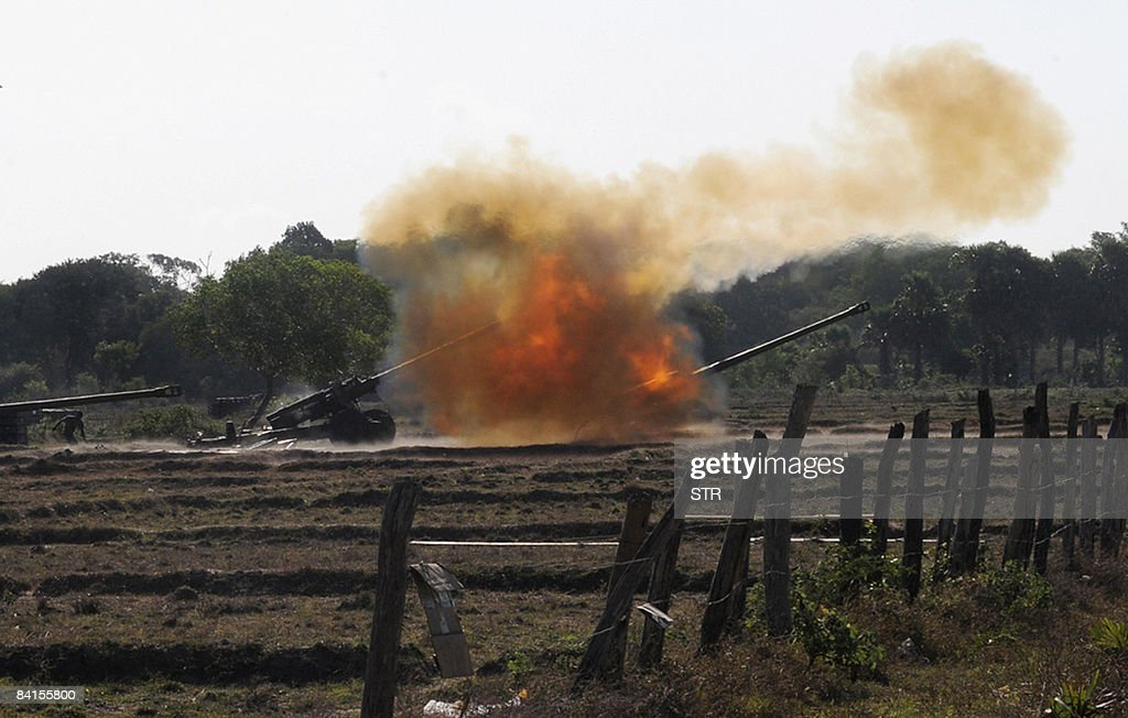 In this picture taken on September 22 Sri Lankan government troops fire artillery at Liberation Tamil Eelam Tiger rebels in Kilinochchi Sri Lankan...