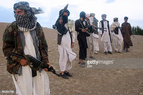 In this picture taken on September 26 Fighters with Afghanistan's Taliban militia stand on a hillside at Maydan Shahr in Wardak province west of...