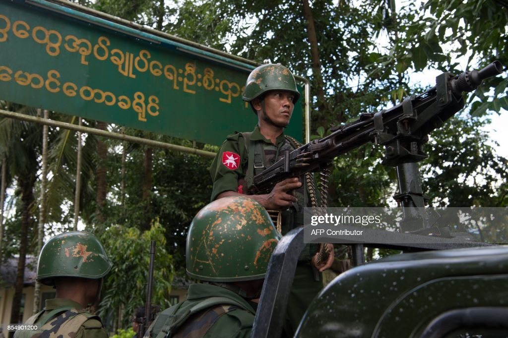 In this picture taken on September 27, 2017, Myanmar soldiers stand guard in Maungdaw in Myanmar's northern Rakhine state. Major clashes between the army and Muslim insurgents erupted last month, triggering a dire refugee crisis with nearly half a million Rohingya fleeing across the border to Bangladesh. /