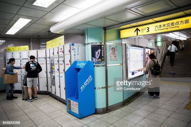 In this picture taken on September 4 a couple use a coin locker at Roppongi subway station in Tokyo Heated toilets that spray users clean train seats...