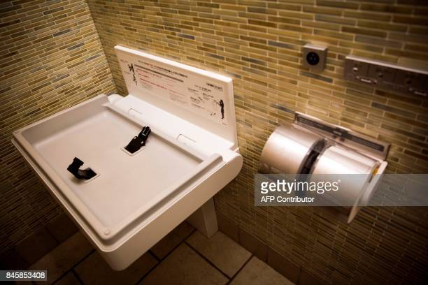 In this picture taken on September 4 a diaperchanging table is seen at a public toilet in a shopping mall in Tokyo Heated toilets that spray users...