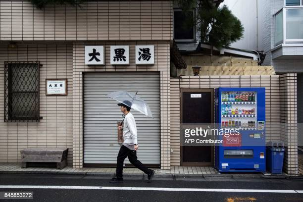 In this picture taken on September 4 a man walks past a vending machine in the Nakameguro district of Tokyo Heated toilets that spray users clean...