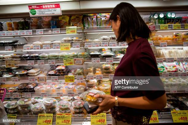 In this picture taken on September 4 a woman shops for some food at a convenience store in the Roppongi district in Tokyo Heated toilets that spray...
