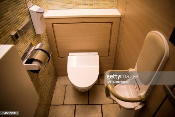 In this picture taken on September 4 an infant seat is seen next to a heated toilet at a public toilet in a shopping mall in Tokyo Heated toilets...