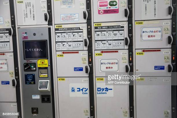 In this picture taken on September 4 coin lockers that work with electronic 'Pasmo' transport cards are pictured at Roppongi station in Tokyo Heated...