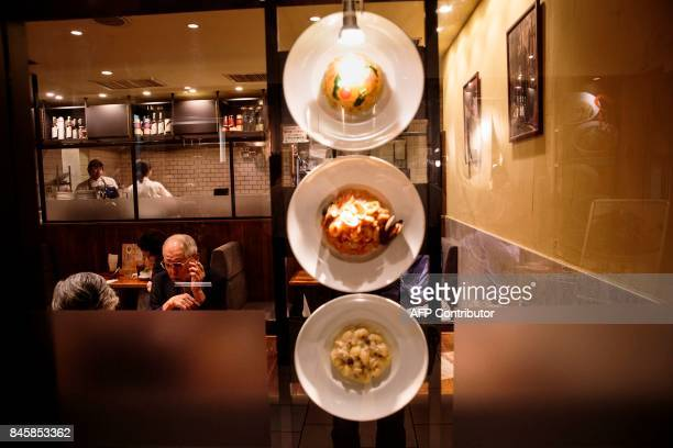 In this picture taken on September 4 plastic food samples are displayed outside a restaurant in the Roppongi district in Tokyo Heated toilets that...