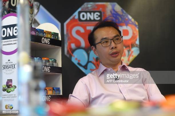 In this picture taken September 20 Malaysian condommaker Karex Industries Chief Executive officer Goh Miah Kiat gestures during an interview with AFP...