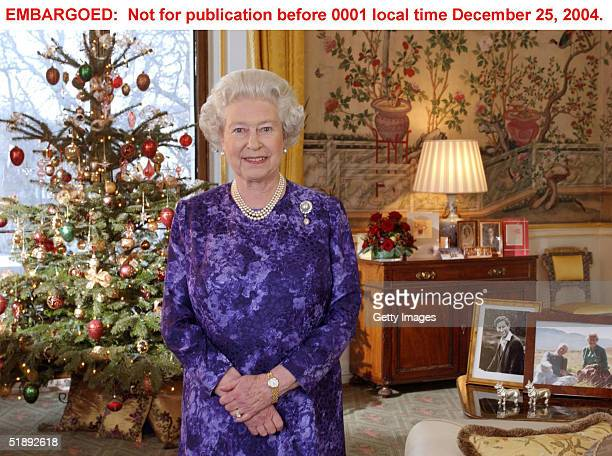 In this pool picture taken December 15 Queen Elizabeth II records her Christmas Day message in the Yellow Drawing Room at Buckingham Palace on...