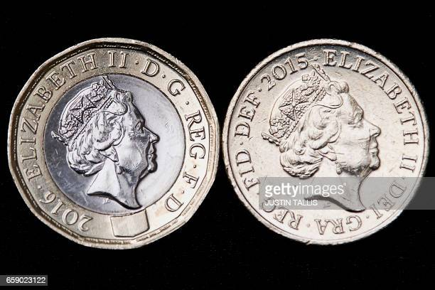 In this posed photograph an old issue £1 coin is pictured alongside a newly issued 12sided £1 coin in London on March 28 2017 Britain's new £1 coin...