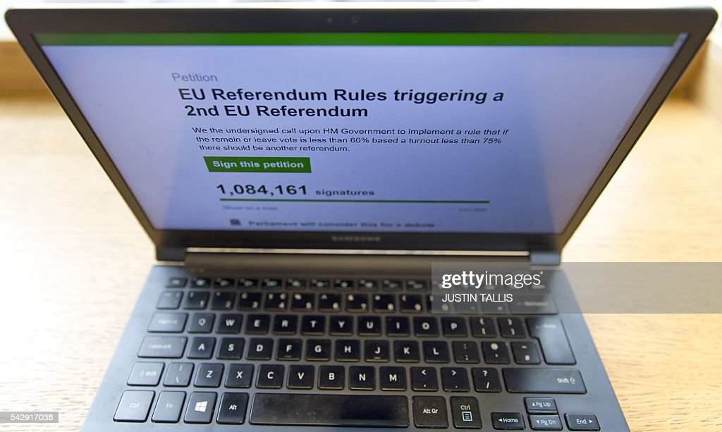 In this posed picture taken in London on June 25, 2016, a laptop screen displays a parliamentary petition on the website of the British government, calling for a 2nd UK referendum on the UK's inclusion within the EU, following the pro-Brexit result of the June 23 vote to leave. More than a million people have signed a petition calling for a second referendum, after 'Leave' voters won a shock victory to pull Britain out of the European Union, an official website showed Saturday. The result of Britain's June 23 referendum vote to leave the European Union (EU) has pitted parents against children, cities against rural areas, north against south and university graduates against those with fewer qualifications. / AFP / JUSTIN