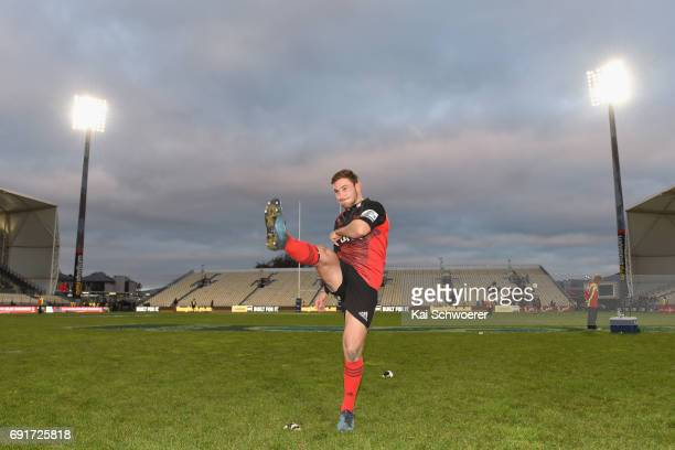 In this posed shot Mitchell Hunt of the Crusaders pretends to be kicking from the spot where he kicked the last minute winning kick during the round...