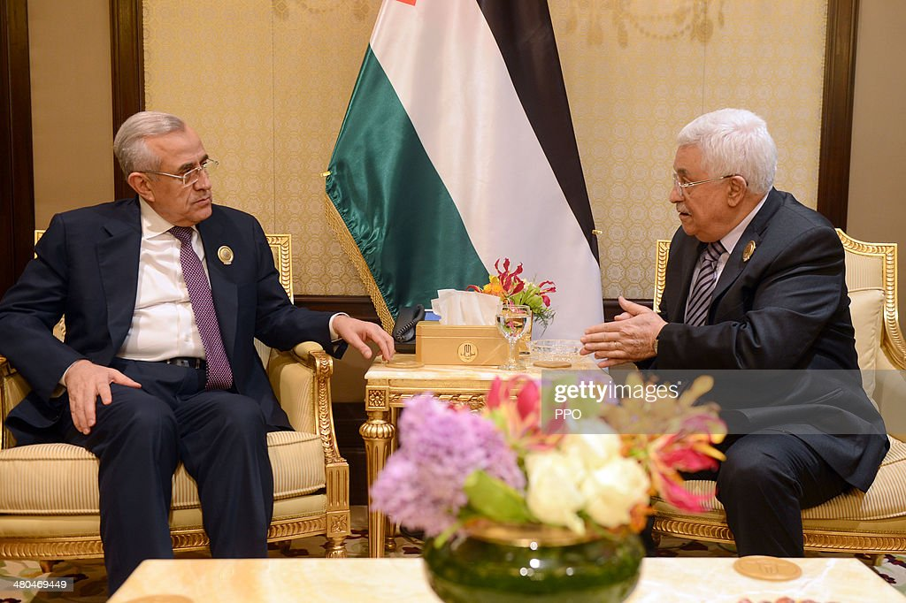 In this PPO handout, Palestinian President Mahmoud Abbas (Abu Mazen) (R) meets with Lebanese President Michel Suleiman while attending the Arab League summit March 25, 2014 in Kuwait, Saudi Arabia. Leaders of Arab nations focused on the conflict in Syria and are expected to hear from its opposition National Coalition (NC) head Ahmad al-Jarba.