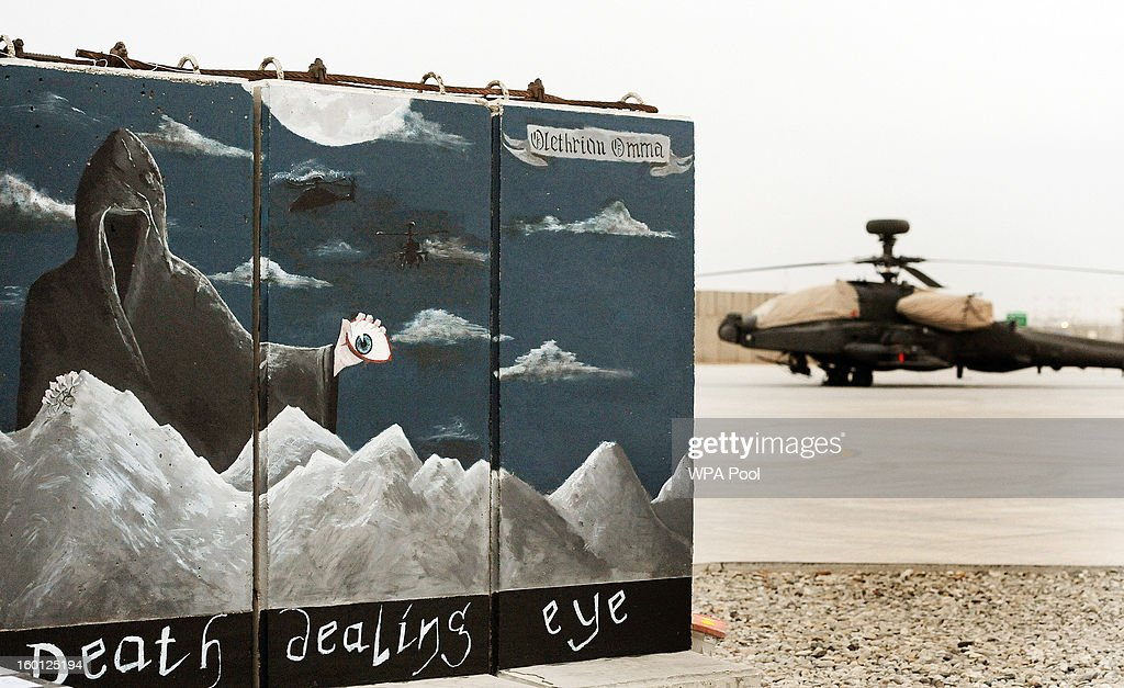 In this previously unissued image released on January 27 a nearly completed hand painted mural from 662 Squadron is seen on a prefabricated blast...