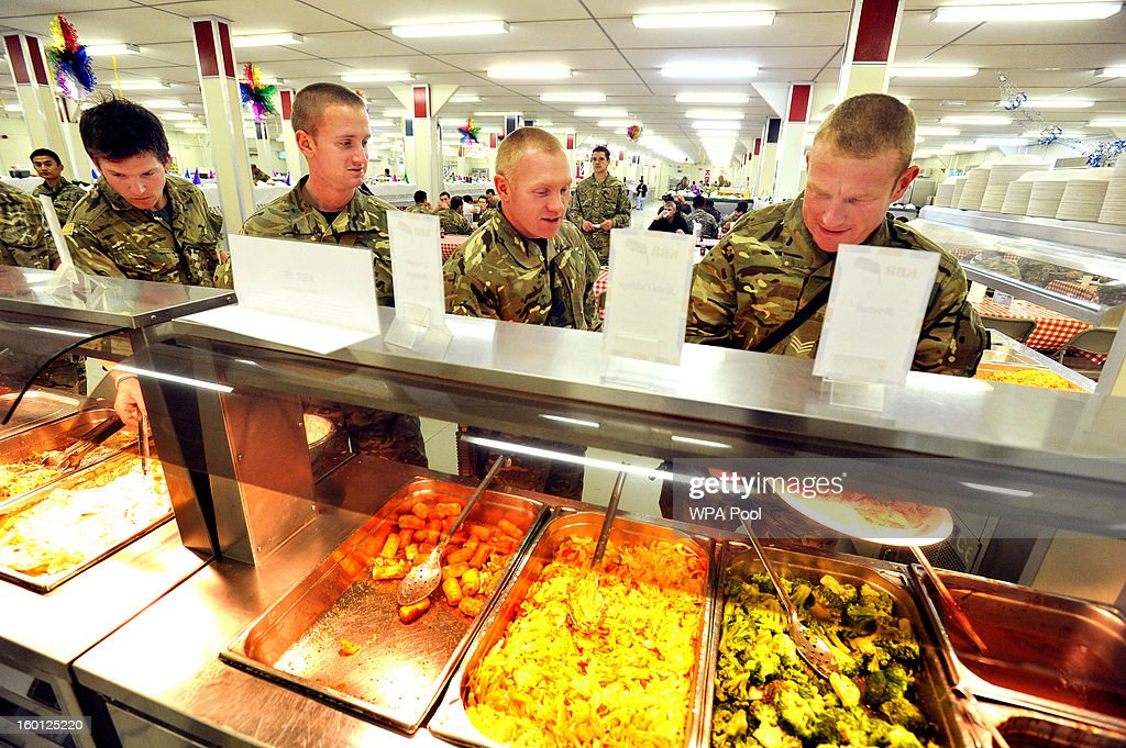 In this previously unissued image released on January 27 British Army Soliders line up at the selfservice food section in the DFAC at Camp Bastion on...