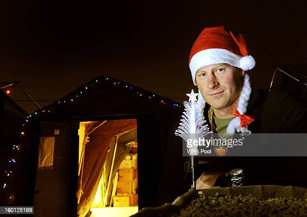In this previously unissued image released on January 27 Prince Harry poses with a Christmas hat as he stands outside the VHR tent at Camp Bastion on...