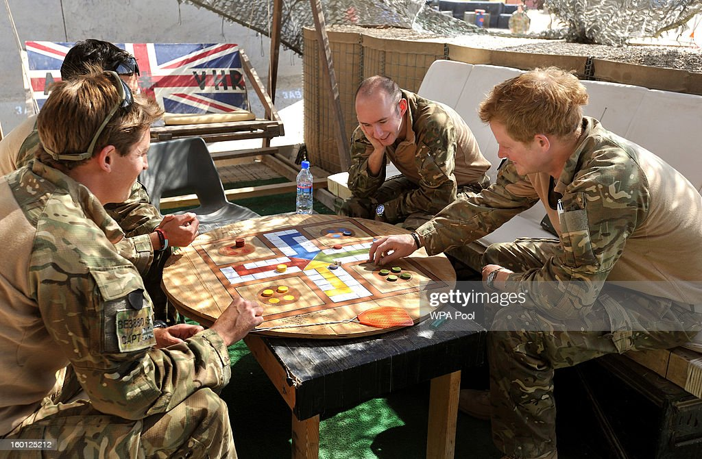 In this previously unissued image released on January 27, 2013, <a gi-track='captionPersonalityLinkClicked' href=/galleries/search?phrase=Prince+Harry&family=editorial&specificpeople=178173 ng-click='$event.stopPropagation()'>Prince Harry</a> (R) plays a game of Uckers in the VHR (very high ready-ness) tent with fellow pilots at the British controlled flight-line at Camp Bastion on November 3, 2012 in Afghanistan. <a gi-track='captionPersonalityLinkClicked' href=/galleries/search?phrase=Prince+Harry&family=editorial&specificpeople=178173 ng-click='$event.stopPropagation()'>Prince Harry</a> has served as an Apache Helicopter Pilot/Gunner with 662 Sqd Army Air Corps, from September 2012 for four months until January 2013.