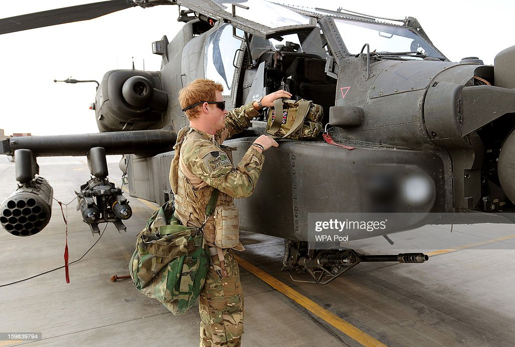In this previously unissued picture, Prince Harry at the British controlled flight-line in Camp Bastion southern Afghanistan, where he has served as an Apache Helicopter Pilot/Gunner with 662 Sqd Army Air Corps on October 31, 2012 in Afghanistan. Prince Harry has served as an Apache Helicopter Pilot/Gunner with 662 Sqd Army Air Corps, from September 2012 for four months until January 2013.