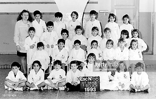 In this reproduction Lionel Messi and students of first grade of elementary school General Las Heras pose for a family picture on 1993 in Rosario...
