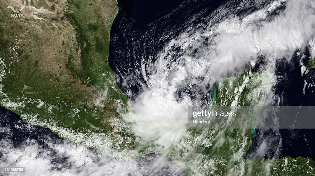 In this satellite handout from National Oceanic and Atmospheric Administration (NOAA), Tropical Storm Nate passes near the Yucatan Peninsula September 8, 2011 as seen from space. Nate has formed in the Gulf of Mexico prompting tropical storm warnings for parts of the Mexican coast.