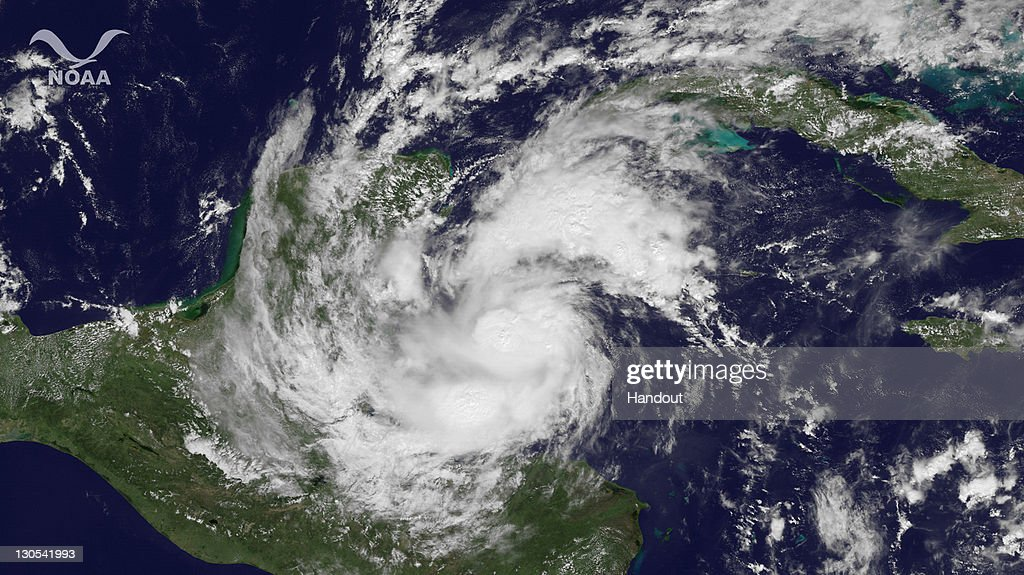 In this satellite handout from National Oceanic and Atmospheric Administration (NOAA), Hurricane Rina churns October 26, 2011 in the Caribbean Sea. According to NOAA Rina is expected to to turn norhward close to teh east coast of Mexico.
