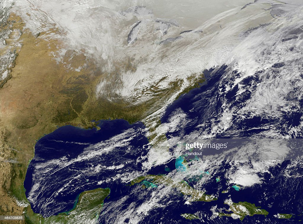 In this satellite handout image provided by National Oceanic and Atmospheric Administration (NOAA), shows a large area of low pressure as it sweeps across the East Coast January 6, 2014. A strong winter storm is bearing down on the East Coast between Virginia and Massachusetts and could dump four to eight inches of snow on the Washington area.