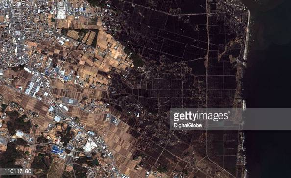 In this satellite image damage is seen after an 89 magnitude earthquake and subsequent tsunami on March 12 2011 in Naraha Japan An earthquake...