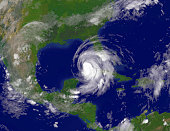 In this satellite image provided by the National Oceanic and Atmospheric Administration Hurricane Ike moves in to the Gulf of Mexico just off the...