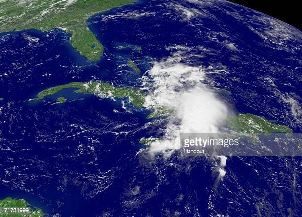 In this satellite image provided by the National Oceanic and Atmospheric Administration Tropical Storm Ernesto is seen at 1245 pm EDT moving over...