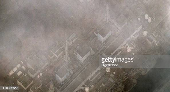 In this satellite view damage caused by an explosion in the building housing reactor 1 at the Fukushima I Dai Ichi Nuclear Power plant can be seen...