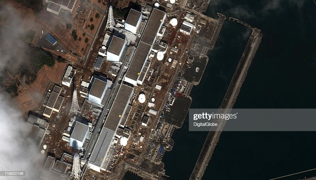 In this satellite view Fukushima DaiIchi Nuclear Power plant is damaged by an earthquake which caused a tsunami March 12 2011 in Okuma Japan An...