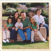 In this scanned handout image released by The Jordanian Royal Palace Jordanian royal couple King Abdullah II and his wife Queen Rania with their...