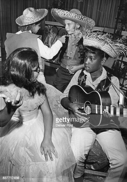 In this scene from 'Loco Burrito' Gloria Trujillo of 2863 Poplar St is serenaded by guitarist Karen Bolt of 3040 Poplar St while in rear Armand...