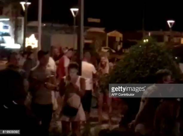 In this screen grab taken from a cell phone video tourists stand outside of the the Marmara ClubHotel after an earthquake in Theologos Greece about...