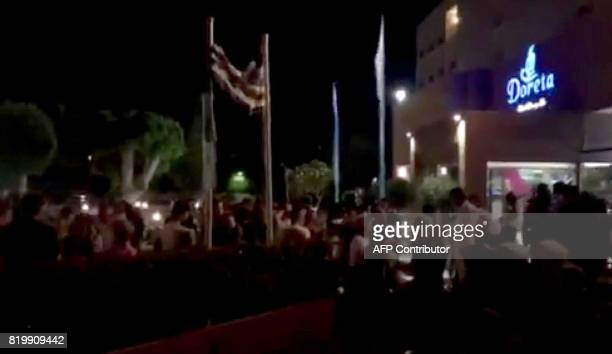 In this screen grab taken from a cell phone video tourists stand outside the Marmara Club Hotel after an earthquake in Theologos Greece about 30 km...